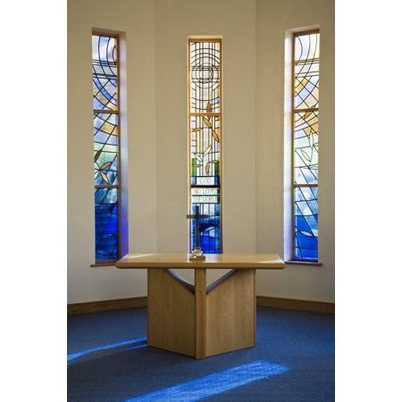 A Table With A Cross And Communion Emblems And Stained Glass Windows Inside A Church Dore Sheffield England Poster Print by John Doornkamp  Design Pics - Stained Glass Crosses