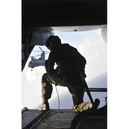 December 4 2011 - US Marine looks out the back of a CH-46E Sea Knight over the Pacific Ocean Poster Print