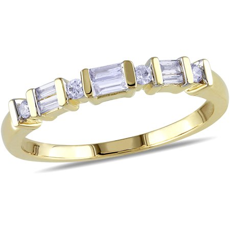 - 1/4 Carat T.W. Round and Baguette Diamond Ring in 10kt Yellow Gold