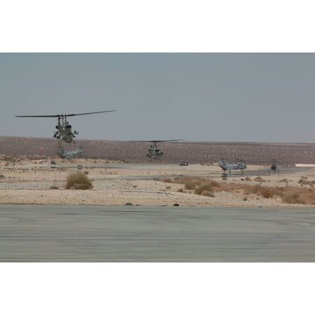 LAMINATED POSTER MARINE CORPS AIR GROUND COMBAT CENTER TWENTYNINE PALMS, Calif.Two AH-1W Super Cobra helicopters r Poster Print 24 x 36