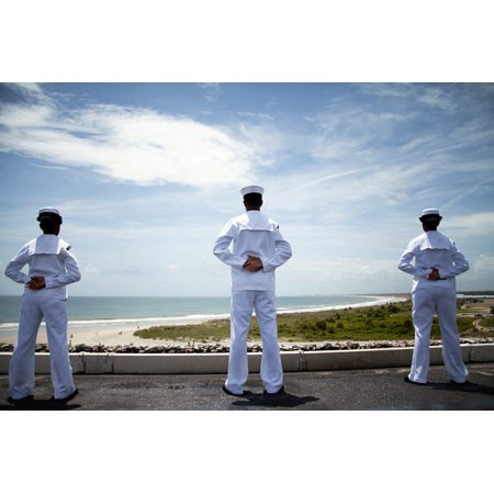 Sailors man the rails as the ship pulls into Naval Station Norfolk Poster Print by Stocktrek Images