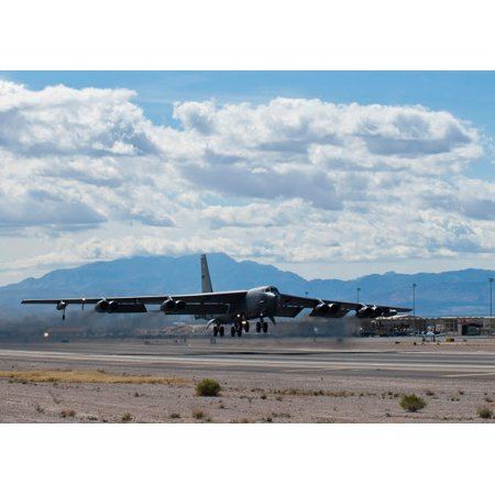 A B-52 Stratofortress takes off from Nellis Air Force Base Poster Print by Stocktrek