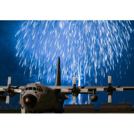 LAMINATED POSTER Fireworks explode behind a C-130 Hercules during Celebrate America, July 2, 2015, at Yokota Air Base Poster Print 24 x