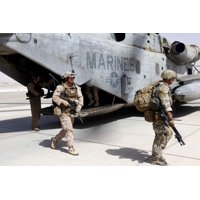 August 31 2013 - US Marines and British soldiers exit a CH-53E Super Stallion at Camp Bastion Helmand province Afghanistan Poster Print