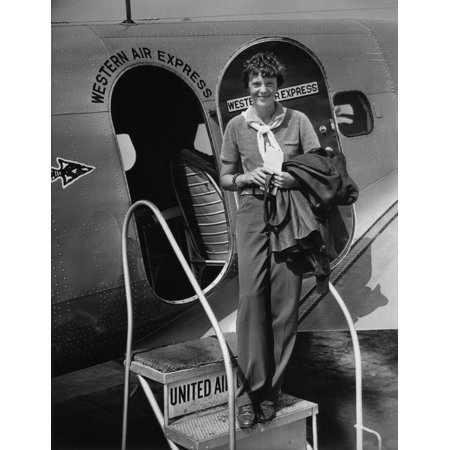Western Airlines (Amelia Earhart 1897-1937 Standing In The Door Of A Western Airlines Planes In California As She Embarks To New York To Make Her First New York First Public Appearance At)