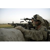 October 9 2009 - US Marines observe the movement of enemy forces during an attack at Patrol Base Bracha in the Garmsir district of Helmand province Afghanistan Poster Print