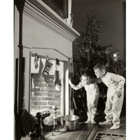 Boy and his sister peeking into a fireplace Poster Print