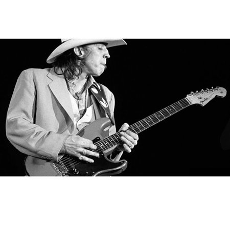 Stevie Ray Vaughan playing guitar in concert with stetson 24x36
