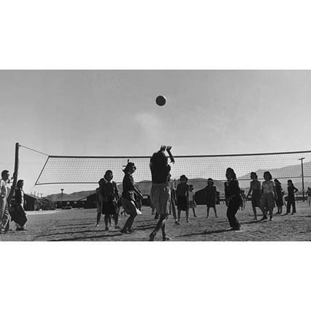 young women playing volleyball buildings in background  Ansel Easton Adams was an American photographer best known for his black-and-white photographs of the American West  During part of his career