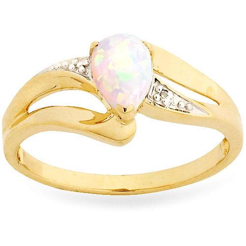 10ky 7x5mm Pear Shape Simulated Opal Rin