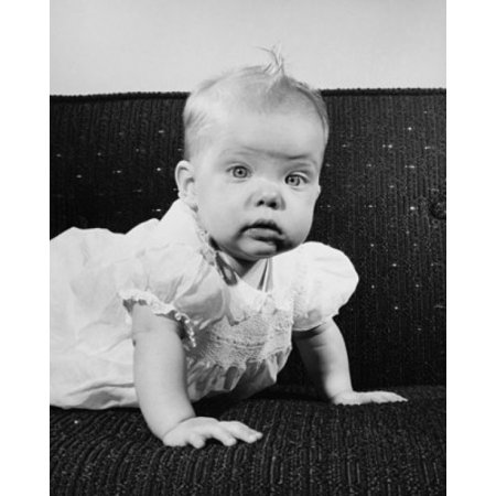 Baby girl crawling on a couch Canvas Art - (18 x 24)
