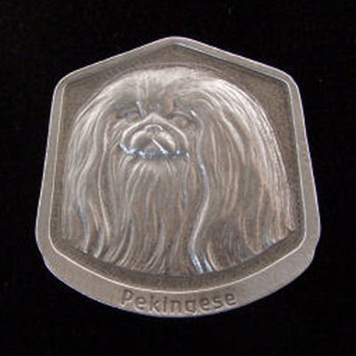 Pekingese Fine Pewter Dog Breed Ornament The sculpted image of your pet is surrounded with a wreath of holly and ivy. You will treasure this ornament for years to come. hey are made of Fine Pewter and come in a Christmas gift box for storing. Lindsay Claire is a Canadian manufacturer of Fine Pewter Gifts and Collectibles.  Each pewter item is cast in our shop from fine pewter and meticulously hand polished to a satin finish.Ornament is approximately 3  and has a satin cord attached for hanging.