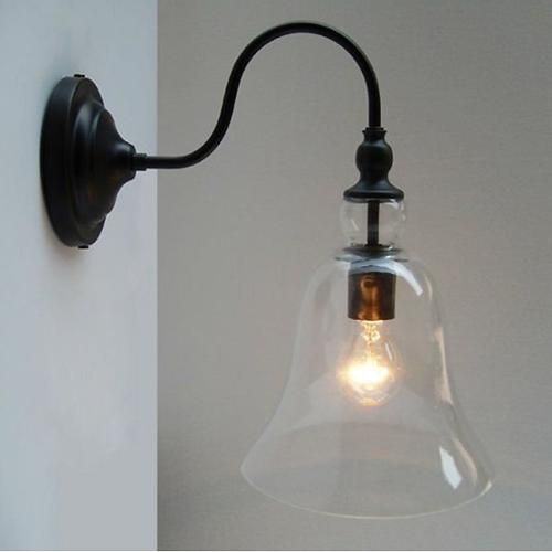 Warehouse of Tiffany Mildred 1-light Clear Glass Edison Wall Lamp with Bulb by Overstock