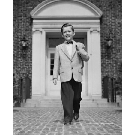 Schoolboy in full suit walking in front of entrance of school building Stretched Canvas -  (24 x 36)