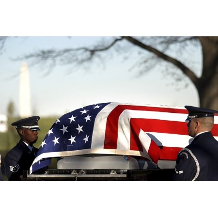 December 11 2006 - US Air Force Honor Guardsmen transfer the casket from the caisson to the grave site during a full honors funeral at Arlington National Cemetery Poster Print