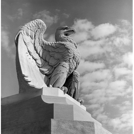 1960s Eagle Statue Against Sky Clouds Wings Spread Feathers Talons Curled Over Edge Of Base Philadelphia 30Th Street