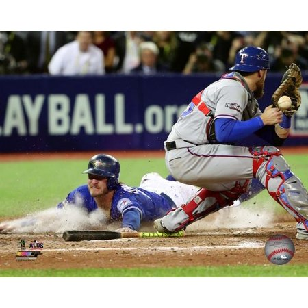 Josh Donaldson scores the game winning run Game 3 of the 2016 American League Division Series Photo Print