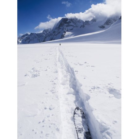 Two distant skiers ski touring across the Ottemma glacier with skinning tracks Switzerland Canvas Art - Penny Kendall Design Pics (13 x 17)