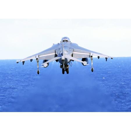 An AV-8B Harrier jet launches off the flight deck of USS Peleliu Poster (Deco Jet)