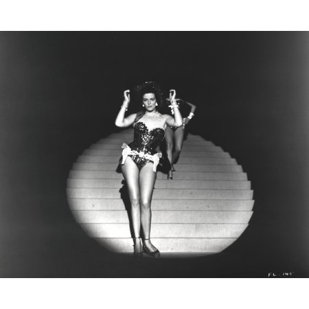 Jane Russell Posed In front of the Spotlight in Black One Piece Sexy Suit and White Garter with Hands Raised Up and Feet Together Photo (Sexy Black And White Photos Of Couples)