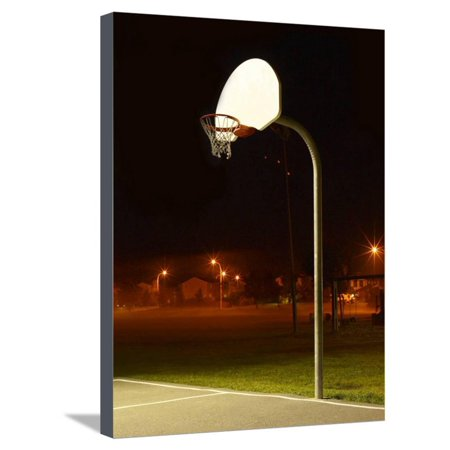Basketball Net and Court Illuminated at Night in a Residential Area Stretched Canvas Print Wall Art
