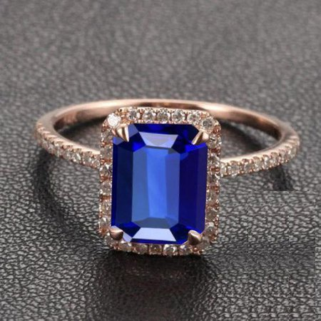 Limited Time Sale: 1.50 Carat Emerald Cut Blue Sapphire and Diamond Engagement