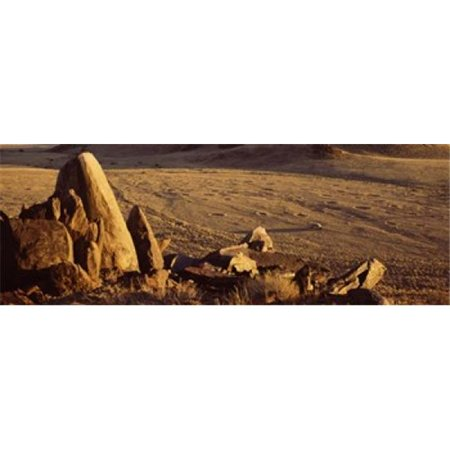 Rocks in a desert  overview of tourist vehicle  Namibia Poster Print by  - 36 x 12 - image 1 de 1