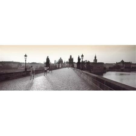 Tourist Walking On A Bridge  Charles Bridge  Prague  Czech Republic Poster Print by  - 36 x 12 - image 1 of 1