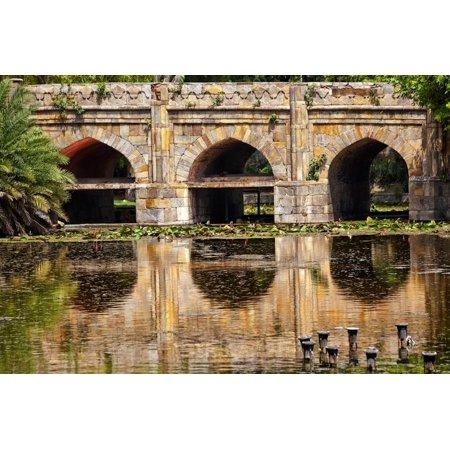 Athpula Eight Piers Stone Bridge, Reflection of Lodi Gardens, New Delhi, India Print Wall Art By William Perry