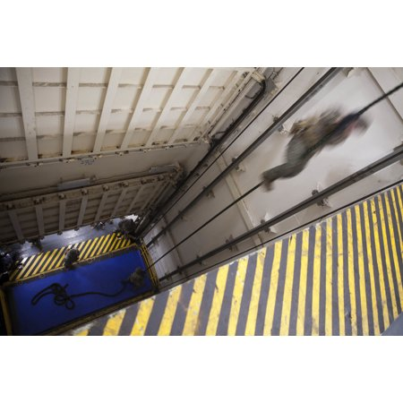 Canvas Print Marines of India Co, 3rd Battalion, 6th Marine Regiment descend from the top of an elevator dock abo Stretched Canvas 10 x (India Docks)