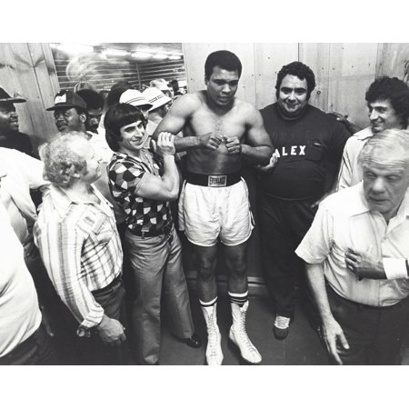 Muhammad Ali posing with fans at boxing glove at a training camp in Pennsylvania Photo