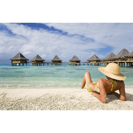 French Polynesia Tuamotu Islands Rangiroa Atoll Woman Lounging On Beach Luxury Resort Bungalows In Background Stretched Canvas - M Swiet Productions  Design Pics (36 x