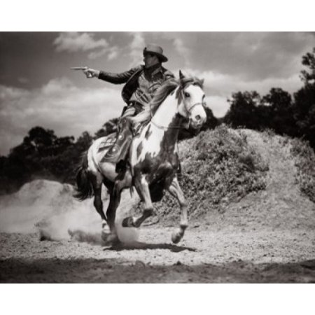 Cowboy riding on a horse shooting with his pistol Poster