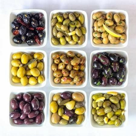 Bowl Frank - Varieties of Olives in bowls on white background Stretched Canvas - Assaf Frank (12 x 12)
