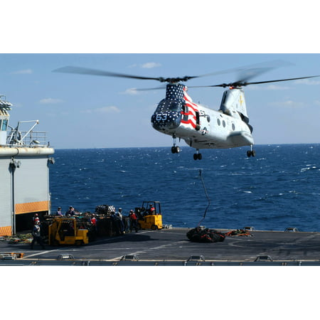 LAMINATED POSTER A CH-46E Sea Knight helicopter carries supplies and stores from the fast combat support ship USS Cam Poster Print 24 x (Fast Ship Discount Outlet Store)