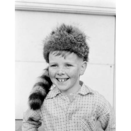 Boy wearing coonskin cap smiling Canvas Art - (18 x 24)