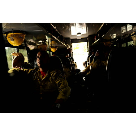 LAMINATED POSTER Members of the Hot Shot firefighter crew from Vandenberg  Air Force Base, Calif , wait in their truck Poster Print 24 x 36