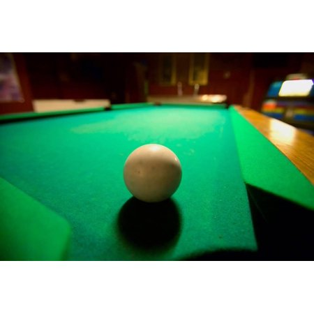 White pool ball lit by electric lights in a restaurant and bar in Shoshone, CA near Death Valley... Print Wall Art (Bau Ca)