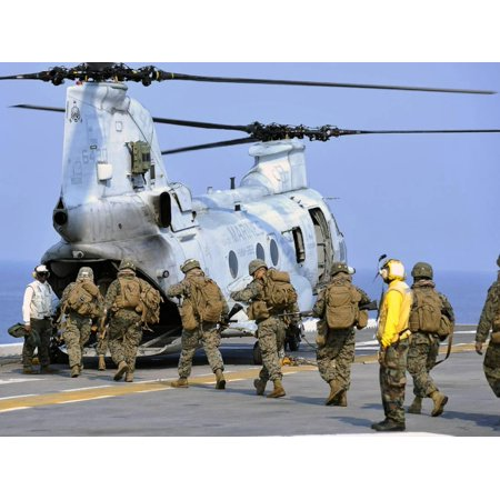 Marines Board a CH-46E Sea Knight Helicopter Print Wall Art By Stocktrek Images