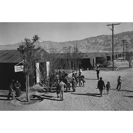 People standing outside Catholic church  Ansel Easton Adams was an American photographer best known for his black-and-white photographs of the American West  During part of his career he was hired