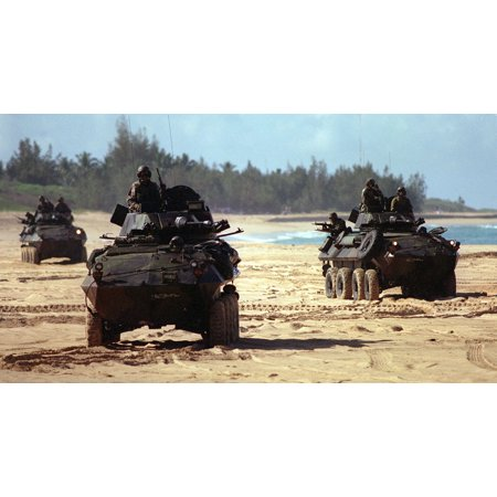 LAMINATED POSTER U.S. Marine Corps Light Armored Vehicles maneuver on the beach during an amphibious landing on June Poster Print 24 x 36