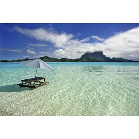 French Polynesia Tahiti Bora Bora Picnic Table And Umbrella In Clear Lagoon Water PosterPrint ()