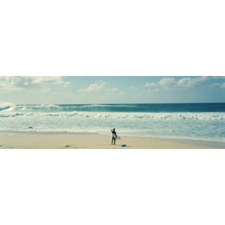 Surfer standing on the beach North Shore Oahu Hawaii USA Canvas Art - Panoramic Images (18 x