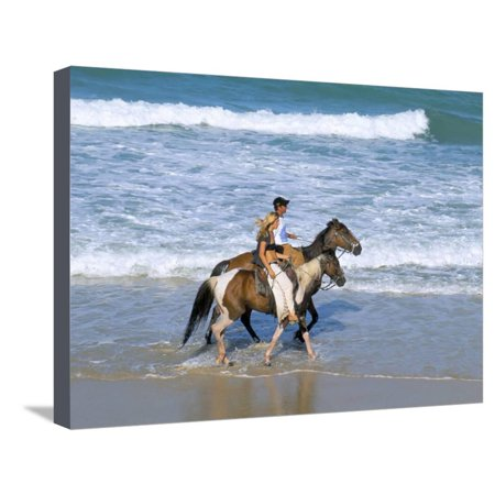 Beach Party Design Grande - Couple Riding Horses on the Beach, Tibau Do Sul, Natal, Rio Grande Do Norte State, Brazil Stretched Canvas Print Wall Art By Sergio Pitamitz