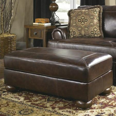 Ashley Furniture Axiom Leather Ottoman in Walnut