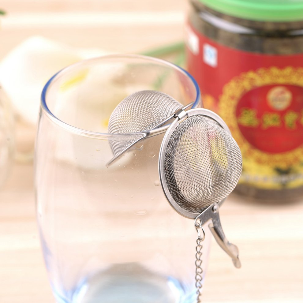 Click here to buy Stainless Steel Sphere Locking Spice Tea Ball Strainer Mesh Infuser tea strainer Filter infusor Mesh Herbal Ball cooking tools.