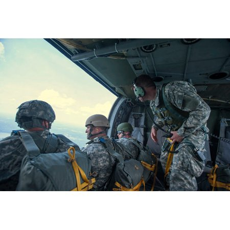 National Guard Special Forces await their turn to jump from a UH-60  Blackhawk Poster Print by Stocktrek Images
