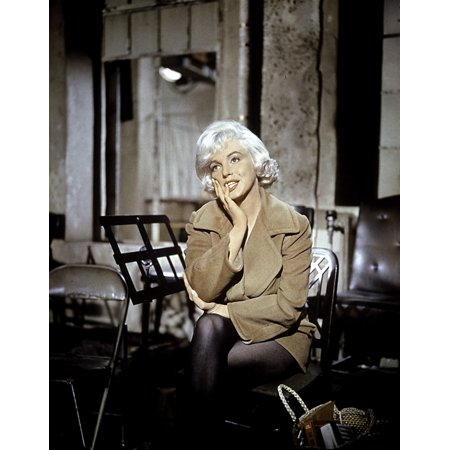 Marilyn Monroe sitting next to a music stand Photo