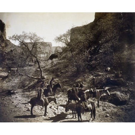 Group Of Navajos C1904 Ngroup Of Navajos Mostly On Horseback At The Bottom Of A Rocky Canyon In The Southwestern United States Photograph By Edward Curtis C1904 Rolled Canvas Art     18 X 24