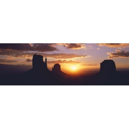 Monument Valley Halloween (Silhouette of buttes at sunset The Mittens Monument Valley Tribal Park Monument Valley Utah USA Canvas Art - Panoramic Images (18 x)